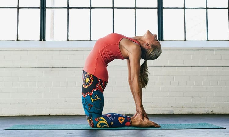 Woman Doing Yoga Camel Pose