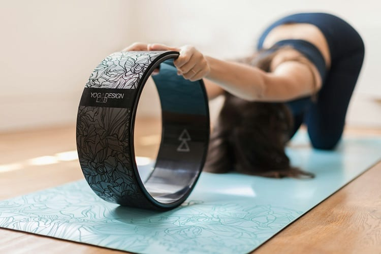 Woman Doing Yoga With Yoga Wheel