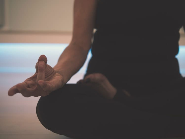 Woman meditating in a lotus pose.