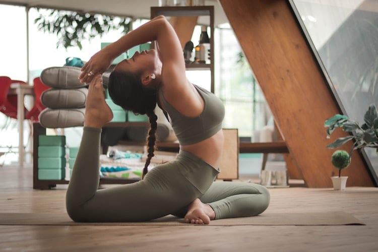 Woman is doing Yoga.